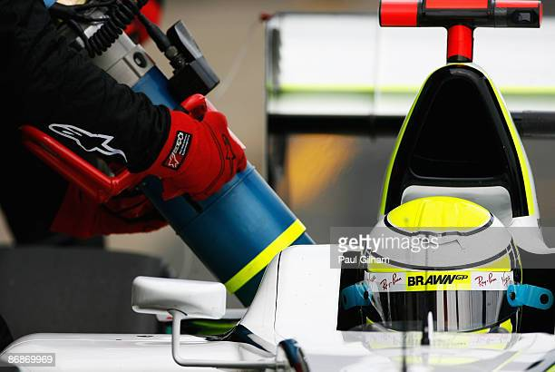 Jenson Button of Great Britain and Brawn GP comes in for refuelling during qualifying for the Spanish Formula One Grand Prix at the Circuit de...