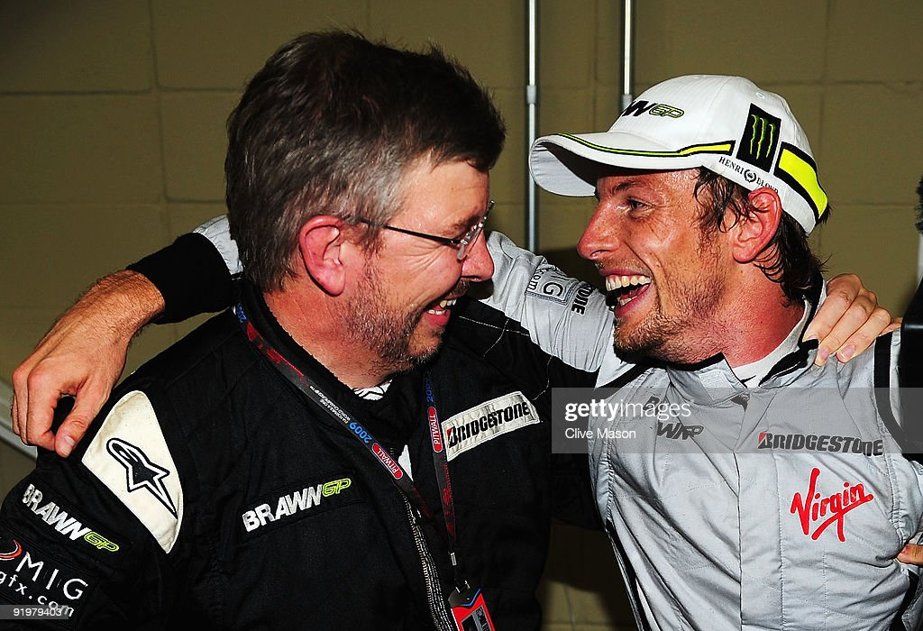 Jenson Button of Great Britain and Brawn GP is congratulated by Brawn GP Team Principal Ross Brawn after clinching the F1 World Drivers Championship...