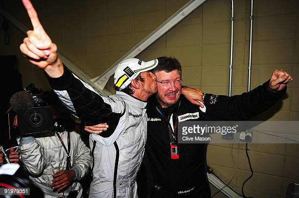 Jenson Button of Great Britain and Brawn GP is congratulated by Team Principal Ross Brawn after clinching the F1 World Drivers Championship during...