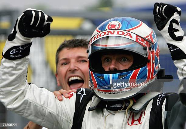 Jenson Button of Great Britain and Honda Racing celebrates his first ever Formula One victory alongside Nick Fry after winning the Hungarian Formula...