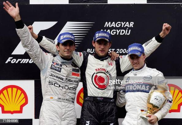 Jenson Button of Great Britain and Honda Racing celebrates with second placed Pedro de la Rosa of Spain and McLarenMercedes and third placed Nick...