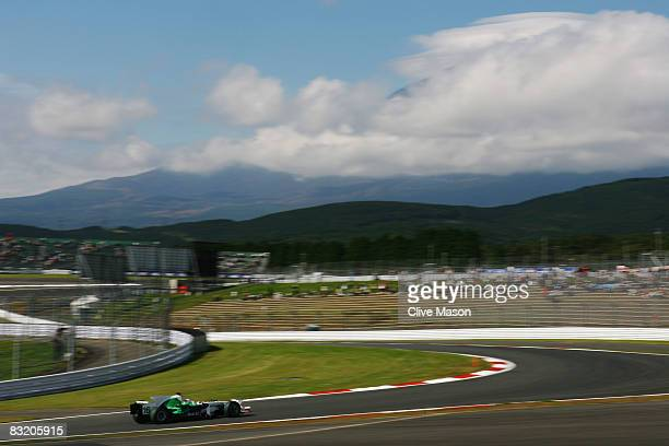Jenson Button of Great Britain and Honda Racing drives as Mount Fuji lays hidden by cloud in the background during practice for the Japanese Formula...