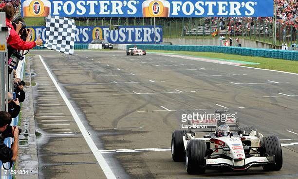 Jenson Button of Great Britain and Honda Racing wins the Hungarian Formula One Grand Prix at the Hungaroring on August 6 2006 in Budapest Hungary