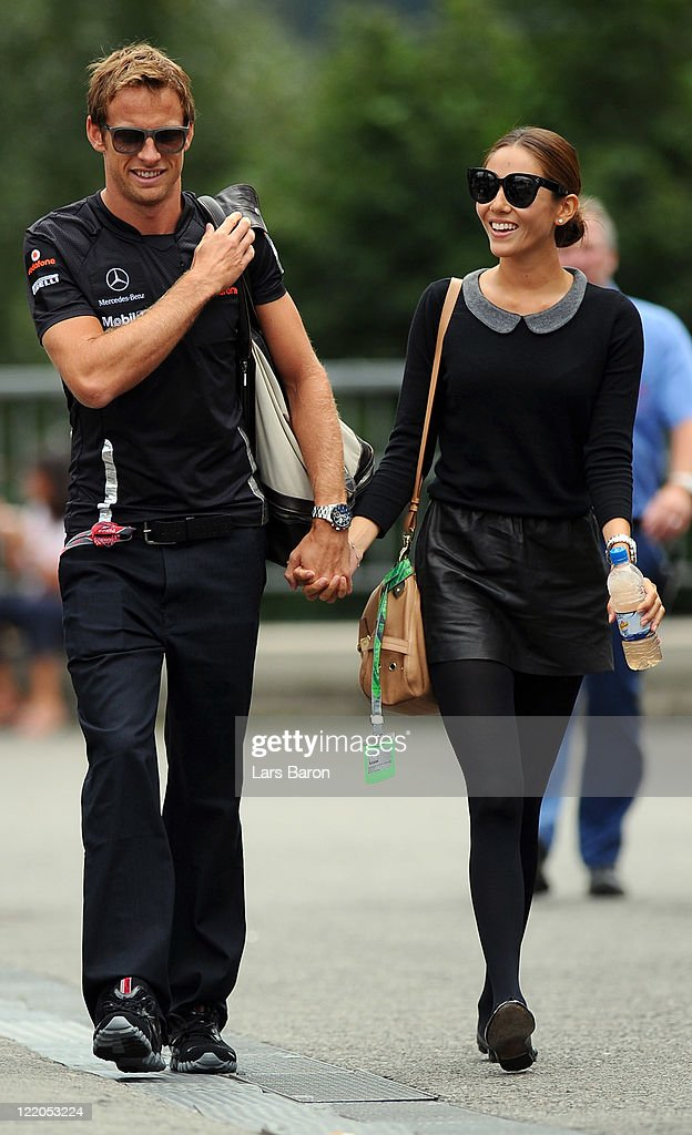 <a gi-track='captionPersonalityLinkClicked' href=/galleries/search?phrase=Jenson+Button&family=editorial&specificpeople=171505 ng-click='$event.stopPropagation()'>Jenson Button</a> of Great Britain and McLaren and his girlfriend <a gi-track='captionPersonalityLinkClicked' href=/galleries/search?phrase=Jessica+Michibata&family=editorial&specificpeople=4193280 ng-click='$event.stopPropagation()'>Jessica Michibata</a> arrive in the paddock during previews to the Belgium Formula One Grand Prix at the Circuit of Spa Francorchamps on August 25, 2011 in Spa, Belgium.