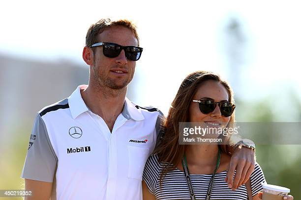 Jenson Button of Great Britain and McLaren and his girlfriend Jessica Michibata arrive at the circuit ahead of final practice ahead of the Canadian...