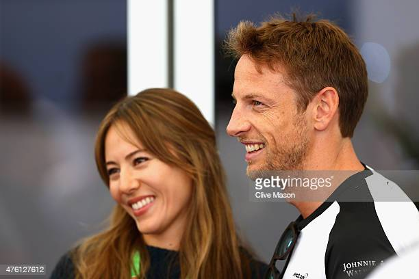 Jenson Button of Great Britain and McLaren and Jessica Michibata are seen following qualifying for the Canadian Formula One Grand Prix at Circuit...