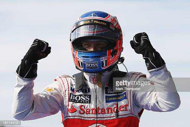 Jenson Button of Great Britain and McLaren celebrates on the podium after winning the Belgian Grand Prix at the Circuit of Spa Francorchamps on...