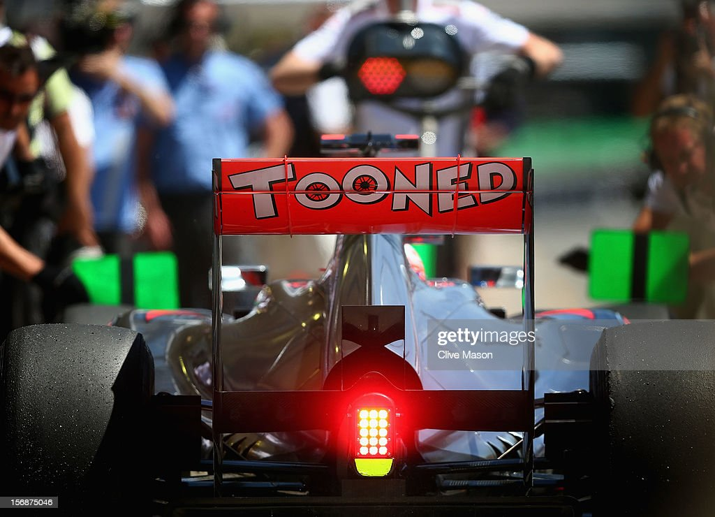 Jenson Button of Great Britain and McLaren drives in for a pitstop during practice for the Brazilian Formula One Grand Prix at the Autodromo Jose Carlos Pace on November 23, 2012 in Sao Paulo, Brazil.