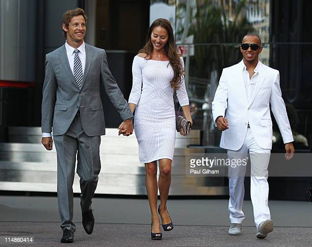 Jenson Button of Great Britain and McLaren his girlfriend Jessica Michibata and Lewis Hamilton of Great Britain and McLaren leave the paddock for the...