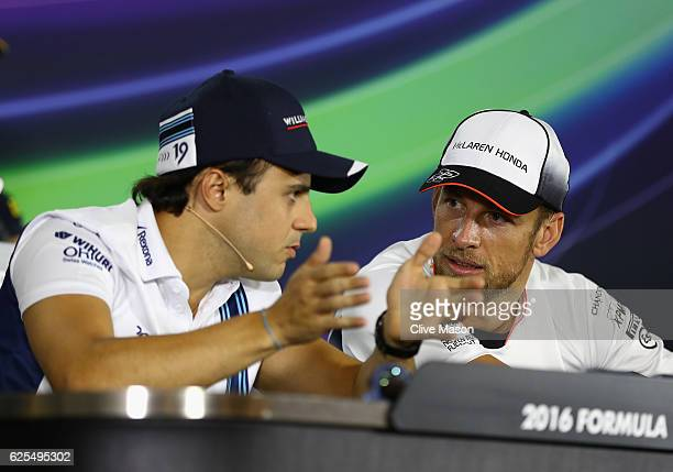 Jenson Button of Great Britain and McLaren Honda and Felipe Massa of Brazil and Williams talk in their final Drivers Press Conference before their...