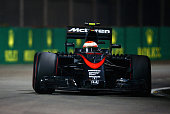 Jenson Button of Great Britain and McLaren Honda drives during the Formula One Grand Prix of Singapore at Marina Bay Street Circuit on September 20...