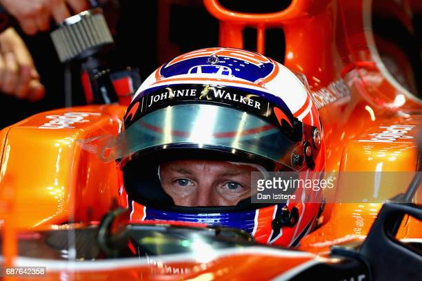 Jenson Button of Great Britain and McLaren Honda during a seat fitting in the garage during previews for the Monaco Formula One Grand Prix at Circuit...