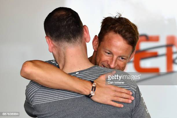 Jenson Button of Great Britain and McLaren Honda greets a McLaren Honda team member during previews for the Monaco Formula One Grand Prix at Circuit...