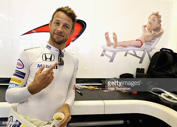 Jenson Button of Great Britain and McLaren Honda in the garage before the Abu Dhabi Formula One Grand Prix at Yas Marina Circuit on November 27 2016...