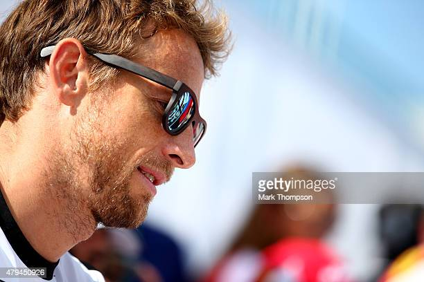 Jenson Button of Great Britain and McLaren Honda looks on during a signing session after qualifying for the Formula One Grand Prix of Great Britain...