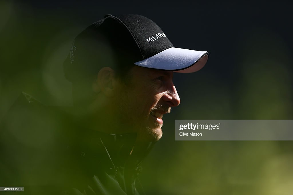 Jenson Button of Great Britain and McLaren Honda looks on in the paddock during previews to the Australian Formula One Grand Prix at Albert Park on March 12, 2015 in Melbourne, Australia.