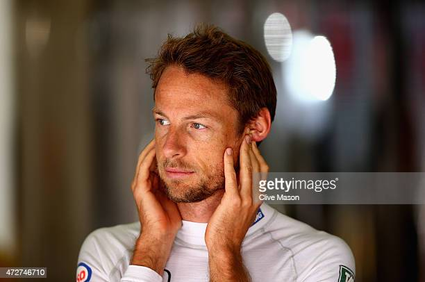 Jenson Button of Great Britain and McLaren Honda looks on in the garage during final practice for the Spanish Formula One Grand Prix at Circuit de...