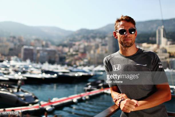 Jenson Button of Great Britain and McLaren Honda poses for a portrait over looking the harbour during previews for the Monaco Formula One Grand Prix...