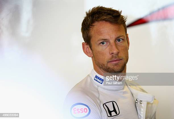 Jenson Button of Great Britain and McLaren Honda prepares in the garage during final practice for the Abu Dhabi Formula One Grand Prix at Yas Marina...