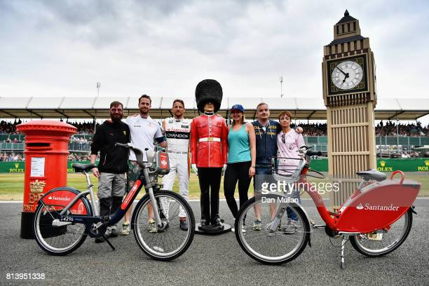 Jenson Button of Great Britain and McLaren Honda Stoffel Vandoorne of Belgium and McLaren Honda Natalie Pinkham and Marc Gene pose for a photo with...