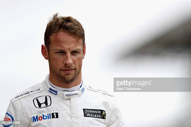 Jenson Button of Great Britain and McLaren Honda walks in the Pitlane during qualifying for the Formula One Grand Prix of Brazil at Autodromo Jose...