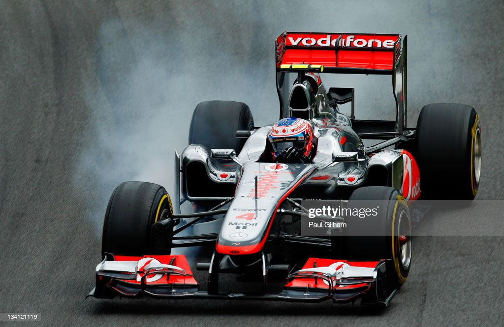 <a gi-track='captionPersonalityLinkClicked' href=/galleries/search?phrase=Jenson+Button&family=editorial&specificpeople=171505 ng-click='$event.stopPropagation()'>Jenson Button</a> of Great Britain and McLaren locks up while driving during qualifying for the Brazilian Formula One Grand Prix at the Autodromo Jose Carlos Pace on November 26, 2011 in Sao Paulo, Brazil.