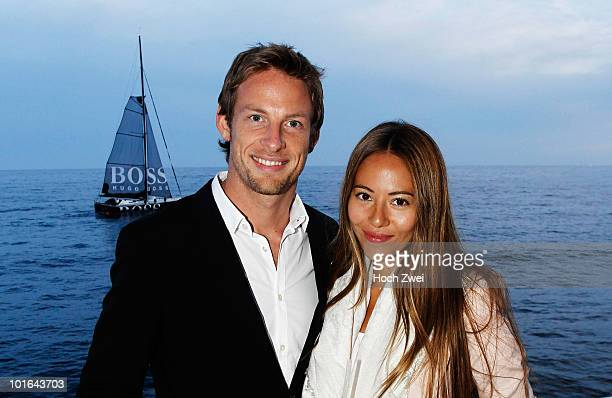 Jenson Button of Great Britain and McLaren Mercedes is seen with girlfriend Jessica Michibata during a Hugo Boss evening in Cap d'Ail on May 14 2010...