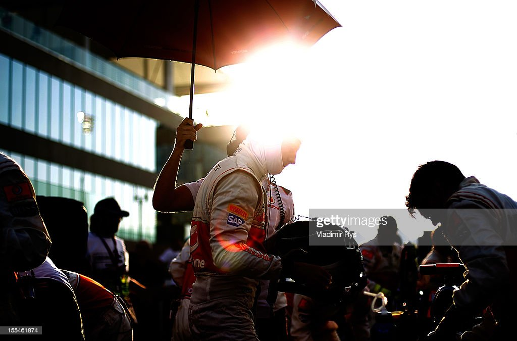 Jenson Button of Great Britain and McLaren prepares on the starting grid ahead of the Abu Dhabi Formula One Grand Prix at the Yas Marina Circuit on November 4, 2012 in Abu Dhabi, United Arab Emirates.