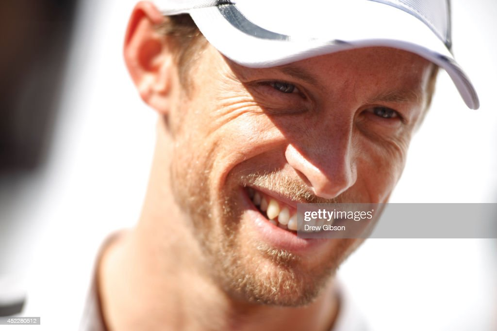 Jenson Button of Great Britain and McLaren smiles as he speaks with members of the medua during previews ahead of the German Grand Prix at Hockenheimring on July 17, 2014 in Hockenheim, Germany.