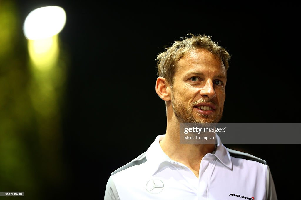 Jenson Button of Great Britain and McLaren walks through the paddock during practice ahead of the Singapore Formula One Grand Prix at Marina Bay...
