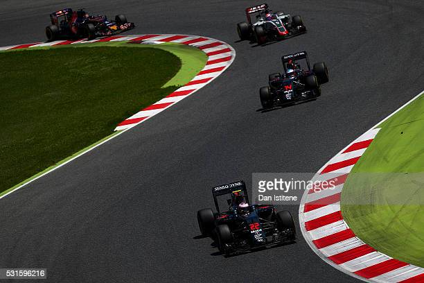 Jenson Button of Great Britain drives the 2 McLaren Honda Formula 1 Team McLaren MP431 Honda RA616H Hybrid turbo ahead of Fernando Alonso of Spain...