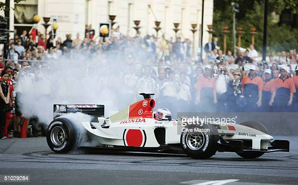 Jenson Button of Great Britain drives the BAR Honda car through the streets of London during the Formula One Regent Street Parade in Regent Street on...