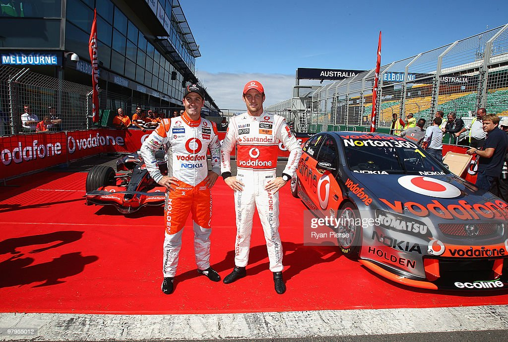 <a gi-track='captionPersonalityLinkClicked' href=/galleries/search?phrase=Jenson+Button&family=editorial&specificpeople=171505 ng-click='$event.stopPropagation()'>Jenson Button</a> (R) of Vodafone McLaren Mercedes F1 Team and <a gi-track='captionPersonalityLinkClicked' href=/galleries/search?phrase=Jamie+Whincup&family=editorial&specificpeople=678654 ng-click='$event.stopPropagation()'>Jamie Whincup</a> (L) of the Vodafone V8 Supercars Team pose during previews for the Australian Formula One Grand Prix at the Albert Park Circuit on March 23, 2010 in Melbourne, Australia. The pair swapped cars in the ultimate driving challenge during a display at the Australian Formula One Grand Prix.