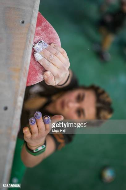 Jenya Kazbekova of Ukraine warms up prior bouldering event Studio Bloc Masters 2017 on March 26 2017 in Pfungstadt Germany