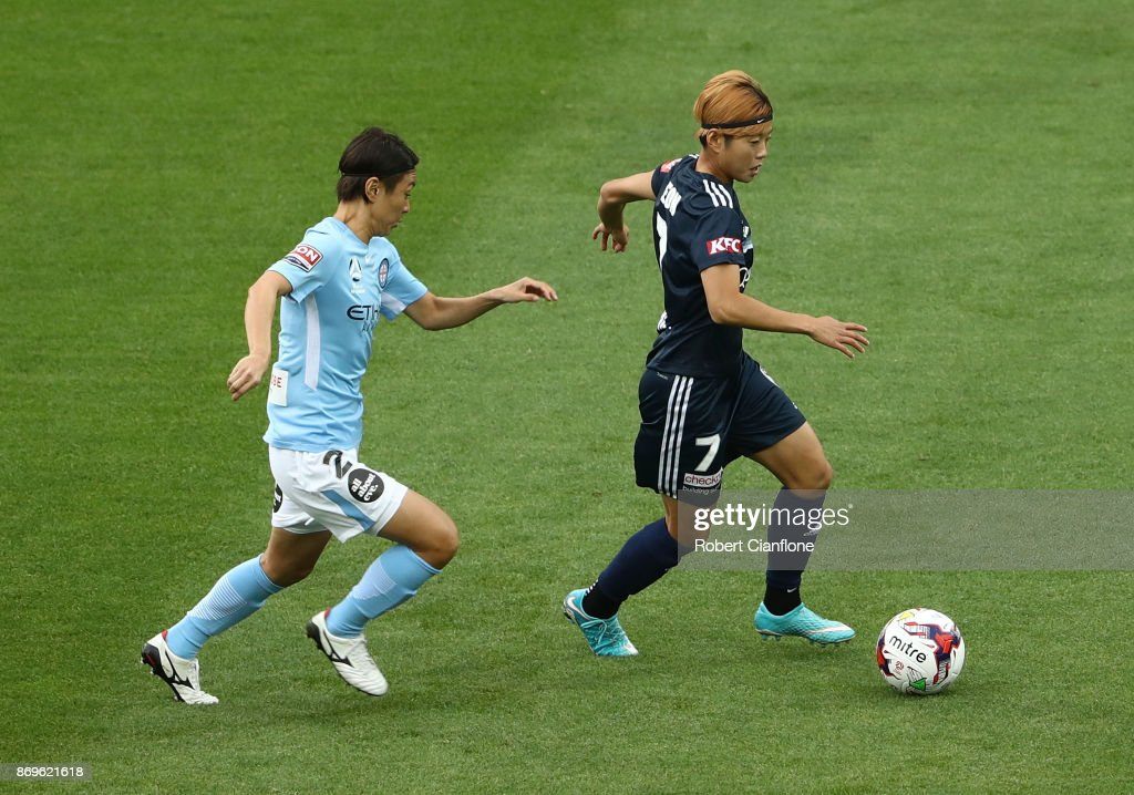 Jeon Ga Eul of the Victory is chased by Yukari Kinga of Melbourne City during the round two W-League match between Melbourne City FC and Melbourne Victory at AAMI Park on November 3, 2017 in Melbourne, Australia.