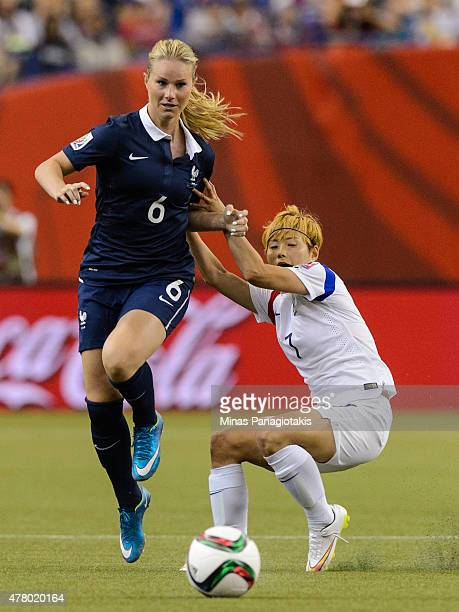 Jeon Gaeul of Korea Republic holds back Amandine Henry of France during the 2015 FIFA Women's World Cup Round of 16 match at Olympic Stadium on June...
