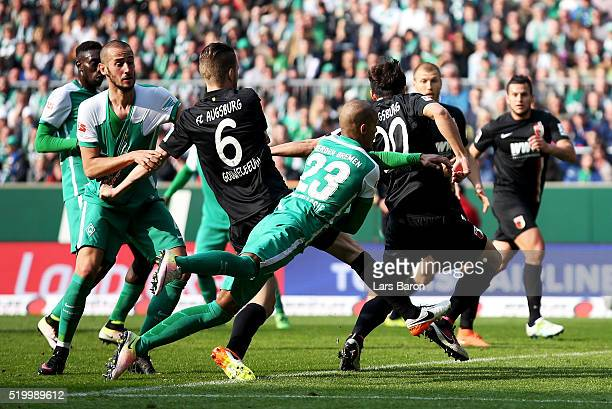 Jeon Ho Hong of Augsburg scores his teams winning goal during the Bundesliga match between Werder Bremen and FC Augsburg at Weserstadion on April 9...
