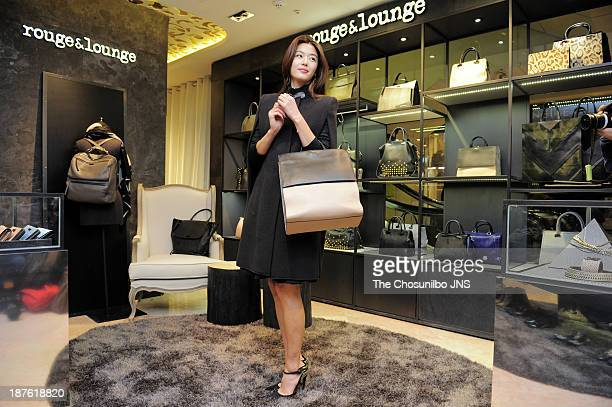 Jeon JiHyun attends the rouge lounge store renewal opening at Lotte department store on November 8 2013 in Seoul South Korea