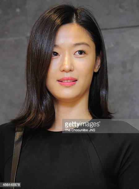 Jeon JiHyun poses for photographs during the rougelounge photowall event at Lotte department store on September 26 2014 in Seoul South Korea