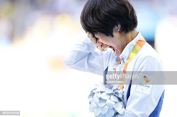 Jeon Min Jae a South Korean sprinter with cerebral palsy cries on the podium amid loud applause from spectators after winning the silver medal in the...