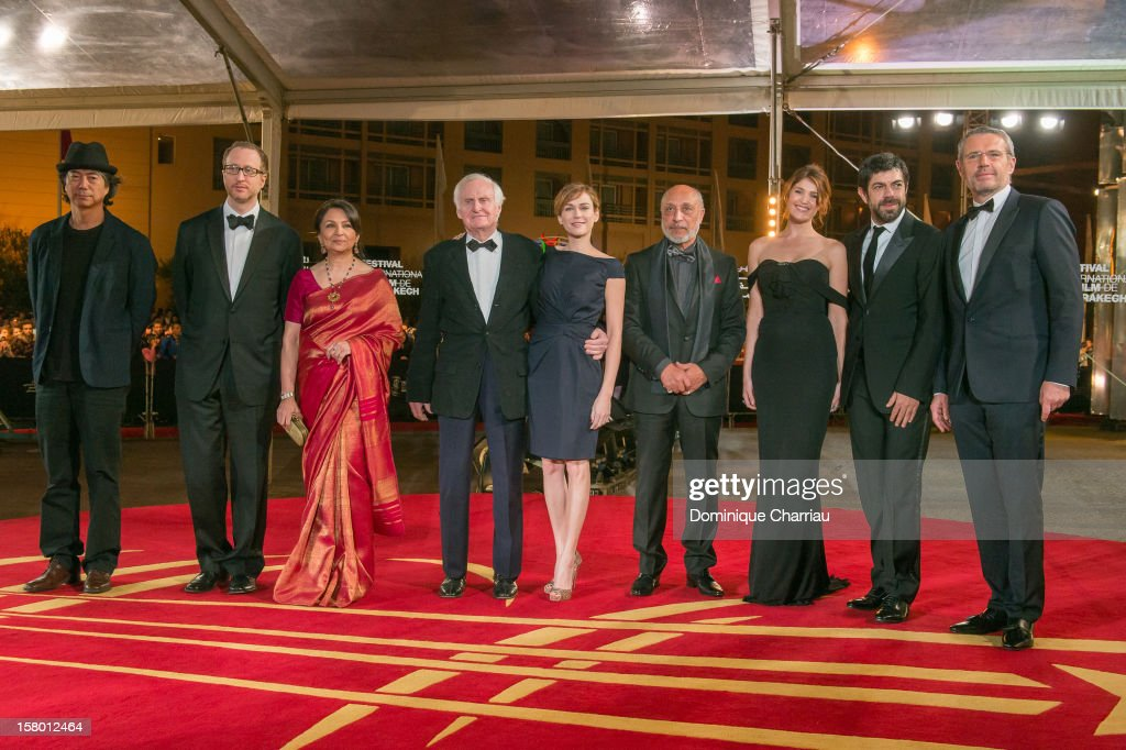 Jeon Soo-Il, James Gray, Sharmila Tagore, John Boorman, Marie-Josee Croze, Jillali Ferhati, Gemma Arterton, Pierfrancesco Favino and Lambert Wilson arrive to the awrard ceremony of the 12th International Marrakech Film Festival on December 8, 2012 in Marrakech, Morocco.