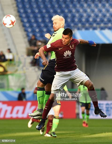 Jeonbuk Hyundai forward Edu vies for the ball with Club America defender Pablo Aguilar during the Club World Cup football match between Jeonbuk...