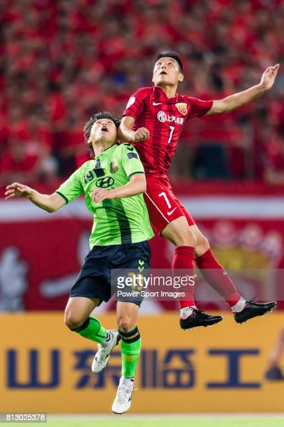 Jeonbuk Hyundai Motors FC defender Park Wonjae fights for the ball with Shanghai SIPG FC forward Wu Lei during the AFC Champions League 2016 Quarter...