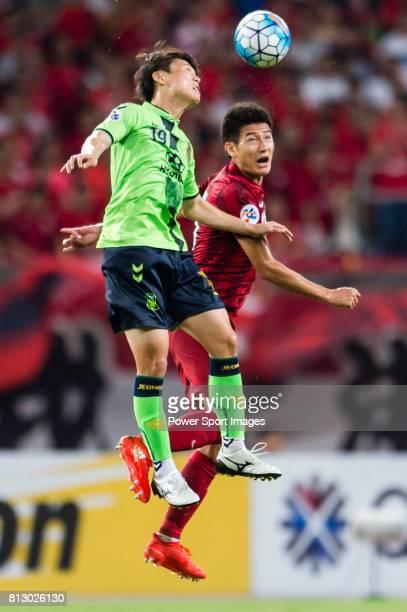 Jeonbuk Hyundai Motors FC defender Park Wonjae fights for the ball with Shanghai SIPG FC forward Yu Hai during the AFC Champions League 2016 Quarter...