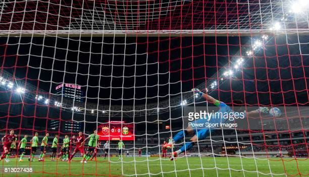 Jeonbuk Hyundai Motors FC goalkeeper Kwoun Suntae reaches for the ball after an attempt at goal by Shanghai SIPG FC during the AFC Champions League...