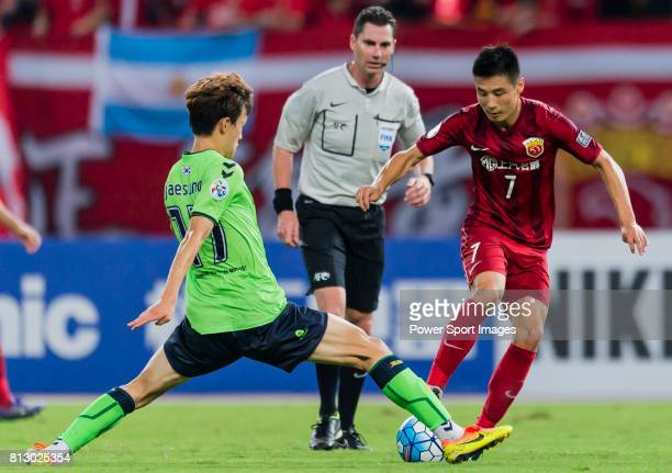 Jeonbuk Hyundai Motors FC midfielder Lee Jae Sung fights for the ball with Shanghai SIPG FC forward Wu Lei during the AFC Champions League 2016...