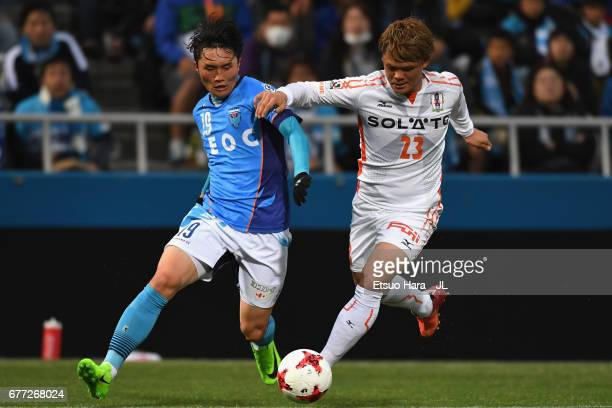 Jeong Chung Geun of Yokohama FC and Makoto Rindo of Ehime FC compete for the ball during the JLeague J2 match between Yokohama FC and Ehime FC at...