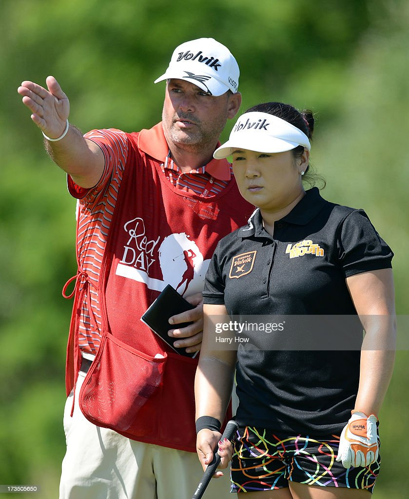 <a gi-track='captionPersonalityLinkClicked' href=/galleries/search?phrase=Jeong+Jang&family=editorial&specificpeople=4300998 ng-click='$event.stopPropagation()'>Jeong Jang</a> of South Korea and her caddie line up her shot on the fourth hole during round two of the Manulife Financial LPGA Classic at the Grey Silo Golf Course on July 12, 2013 in Waterloo, Canada.