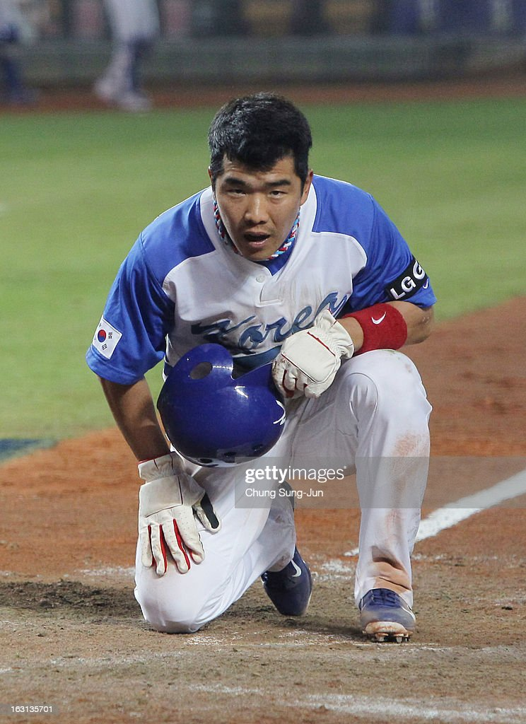 Jeong Keun-Woo of South Korea reacts after being tagged out on the home in the fifth inning during the World Baseball Classic First Round Group B match between Chinese Taipei and South Korea at Intercontinental Baseball Stadium on March 5, 2013 in Taichung, Taiwan.