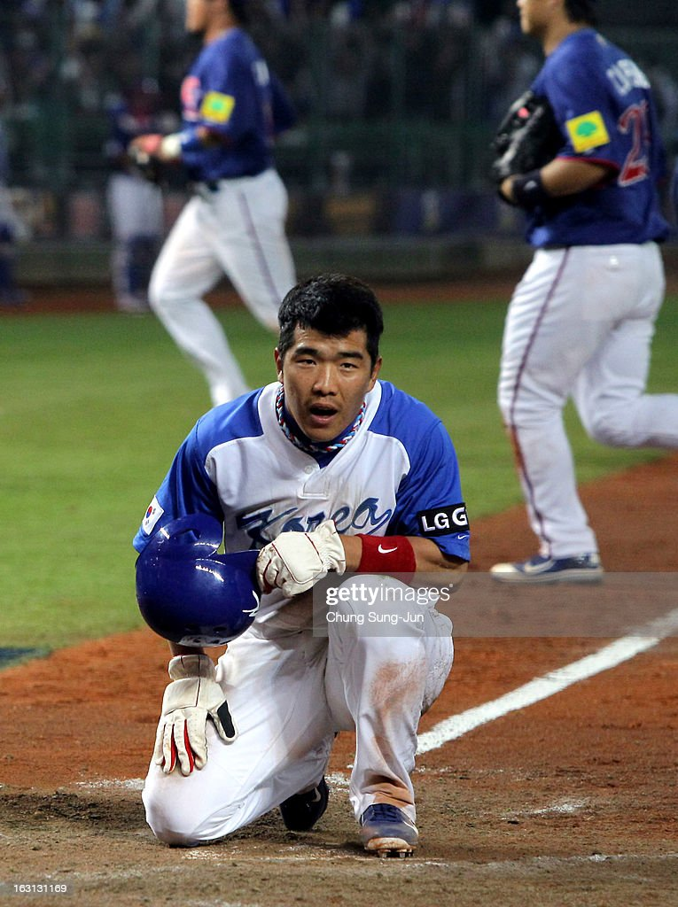Jeong Keun-Woo of South Korea reacts after being tagged out on the home base in the fifth inning during the World Baseball Classic First Round Group B match between Chinese Taipei and South Korea at Intercontinental Baseball Stadium on March 5, 2013 in Taichung, Taiwan.